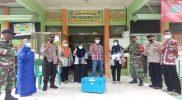 Vaksin Covid-19 tiba di Puskesmas Gaji dengan pengawalan ketat aparat gabungan TNI dan Polri, Kamis (28/1).
